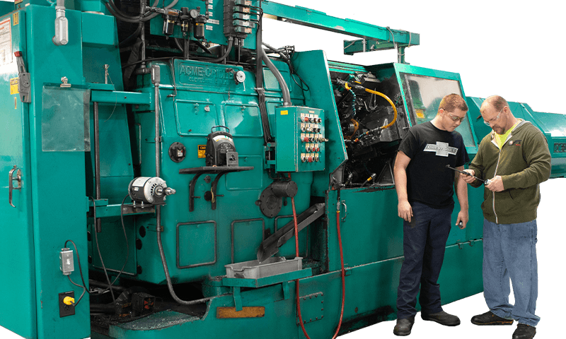 Workers in front of Screw Machine